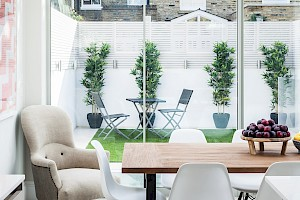 Informal dining area with view of the outside Patio - Basement conversion Fulham.