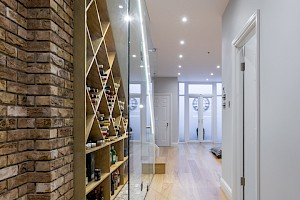 Basement Conversion Clapham entrance with custom made glass panelled wine cellar