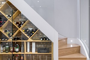 Custom made wine cellar in basement conversion Clapham.