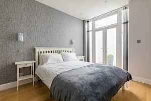 Additional bedroom created in basement conversion, London.