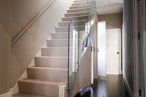 Basement Conversion Clapham staircase with glass balustrade design.