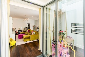 Basement conversion London with playroom and access to outdoor space.