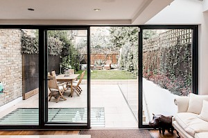 This basement conversion clapham has a rear garden with walk on glass feature.