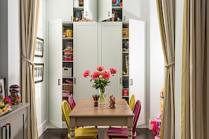 Informal dining area with closet storage as part of a basement conversion Clapham, London.