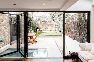 This basement conversion Clapham, London has Bi-fold doors to rear garden.